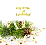 Christmas fir branch with pine cones, gold streamers Royalty Free Stock Image