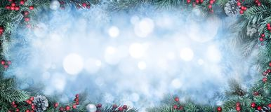 Christmas fir branches and bokeh background. Christmas Background with frosty fir branches as a frame around blue bokeh copy space stock photos
