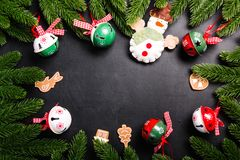 Christmas fir branches with decorations on a black background Royalty Free Stock Image
