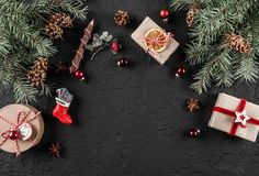 Christmas fir branches, pine cones, gifts on dark background. Xmas and New Year theme., snow. Flat lay, top view,. Space for text royalty free stock image