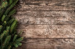 Christmas fir branches on wooden background. Xmas and New Year theme. Flat lay, top view royalty free stock photo