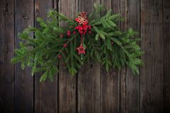 Christmas fir branchs on dark wooden background. Christmas fir branchs on old dark wooden background royalty free stock images