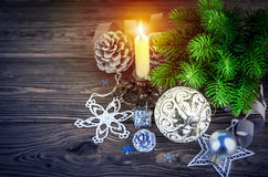 Christmas fir with burning candle decoration pinecone Royalty Free Stock Photos