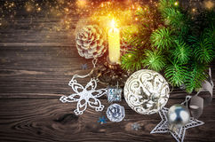 Christmas fir with burning candle decoration pinecone Stock Image