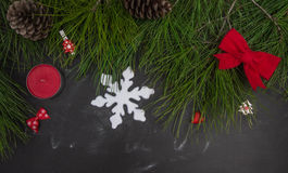 Christmas fir garland with handmade decorations in background blackboard Royalty Free Stock Images