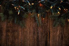 Christmas. Fir with garland on the table Royalty Free Stock Photography