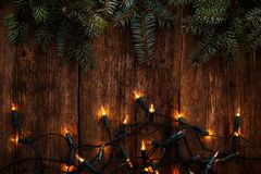 Christmas. Fir with garland on the table Royalty Free Stock Image