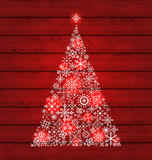 Christmas fir made of snowflakes on wooden backgro Stock Photography