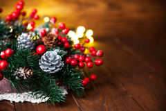 Christmas fir with pinecone and garland Royalty Free Stock Image