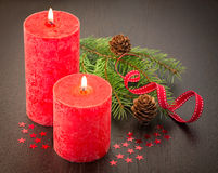 Christmas : fir sprig,candles, cones Stock Photo