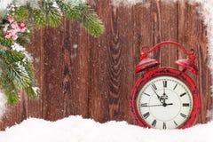 Christmas fir tree and alarm clock Royalty Free Stock Photo