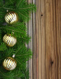 Christmas fir-tree with baubles on background Royalty Free Stock Images