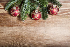 Christmas fir tree with baubles on rustic wooden board Stock Photo