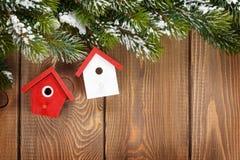 Christmas fir tree and birdhouse decor Stock Images