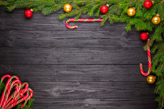 Christmas fir tree on black wooden background Royalty Free Stock Photos