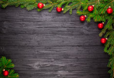 Christmas fir tree on black wooden background Royalty Free Stock Photography