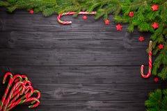 Christmas fir tree on black wooden background Stock Photos