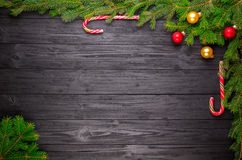 Christmas fir tree on black wooden background Stock Image