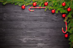 Christmas fir tree on black wooden background Royalty Free Stock Images