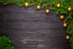 Christmas fir tree on black wooden background Stock Photography