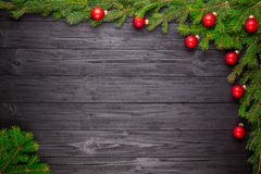Christmas fir tree on black wooden background Royalty Free Stock Photo