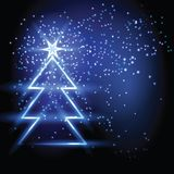 Christmas fir tree on blue background. Royalty Free Stock Photography