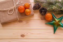 Christmas fir tree branch, gift box, mandarins and star Royalty Free Stock Photo