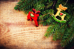 Christmas Fir Tree Branch on rustic  wooden background with fest Stock Image