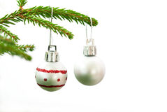 Christmas Fir Tree Branch With Two Silver Christmas Balls. Two Silver And Red Christmas Balls Hanging On A Christmas Fir Tree Branch On A White Isolated royalty free stock images