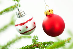 Christmas Fir Tree Branch With Two Silver And Red Christmas Balls Royalty Free Stock Photos