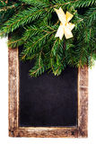 Christmas Fir Tree Branch on Vintage Blackboard frame isolated o Royalty Free Stock Image