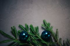 Christmas fir tree branches over dark background with copy space stock photography