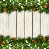 Christmas fir tree branches with snow on white wooden background. Christmas theme with holiday decorations, decorative spruce branches with pine cones and snow Royalty Free Stock Image
