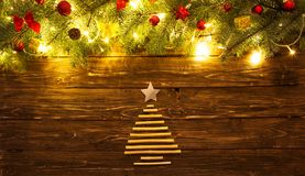 Christmas fir tree branches with toys on wooden table. Christmas background with fir tree and decoration with Christmas tree for dry sticks on dark wooden royalty free stock photos