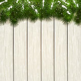 Christmas fir tree branches on white wooden background. Christmas theme, decorative spruce branches and snow on a white wooden background, illustration Royalty Free Stock Photography