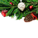 Christmas fir tree brunch  with decoration over white ba Royalty Free Stock Image