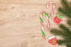 Christmas fir tree and candy cane Royalty Free Stock Image