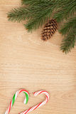 Christmas fir tree and candy cane Royalty Free Stock Photos