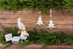 Christmas fir tree, Christmas tree toys, gifts on old wooden board background. Toned Royalty Free Stock Image