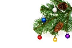 Christmas fir-tree with cones and New Year's toys. Christmas fir-tree, branch with cones and New Year's toys, jewelry from the multi-colored brilliant balls Royalty Free Stock Photography