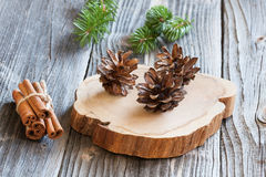 Christmas fir tree and cones. On wood background Stock Photo