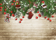Christmas fir tree with cookie,holly and decoration on wooden bo Stock Photo
