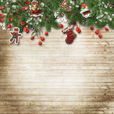Christmas fir tree with cookie,holly and decoration on wooden bo. Christmas background with gingerbread,cookies and fir branches and decorative ornaments on a Stock Photography