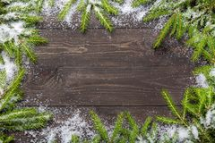 Christmas fir tree on a dark wooden board with snow. Christmas or new year frame for your project with copy space. stock images
