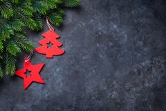 Christmas fir tree and decor over stone background Stock Images
