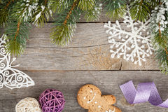Christmas fir tree and decor on wooden board background Royalty Free Stock Image