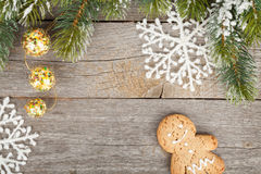 Christmas fir tree and decor on wooden board background Stock Image