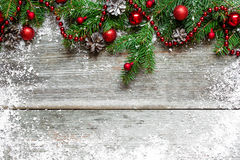 Christmas fir tree decorated on wooden background Stock Images