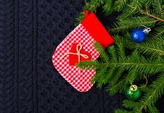 Christmas fir tree with decoration on dark blue knitted wool background Stock Images