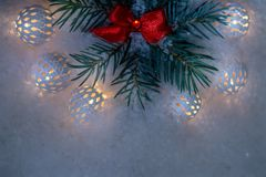 Christmas fir tree with decoration on dark wooden board background. stock photos